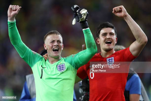 Jordan Pickford and Harry Maguire of England celebrate victory following the 2018 FIFA World Cup Russia Round of 16 match between Colombia and...