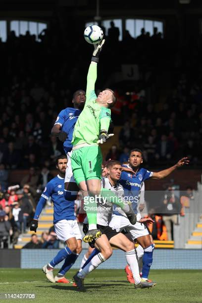 Jordan Pickford and Kurt Zouma of Everton jump for the ball during the Premier League match between Fulham FC and Everton FC at Craven Cottage on...