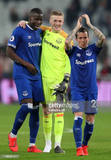 Jordan Pickford Kurt Zouma and Bernard of Everton celebrate victory after the Premier League match between West Ham United and Everton FC at London...