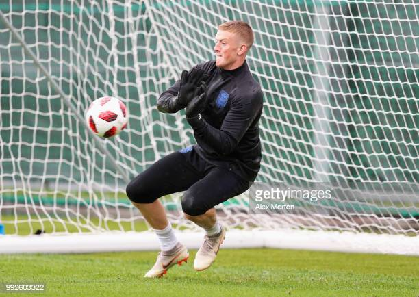 Jordan Pickford makes a save during an England training session at Spartak Zelenogorsk Stadium on July 6 2018 in Saint Petersburg Russia