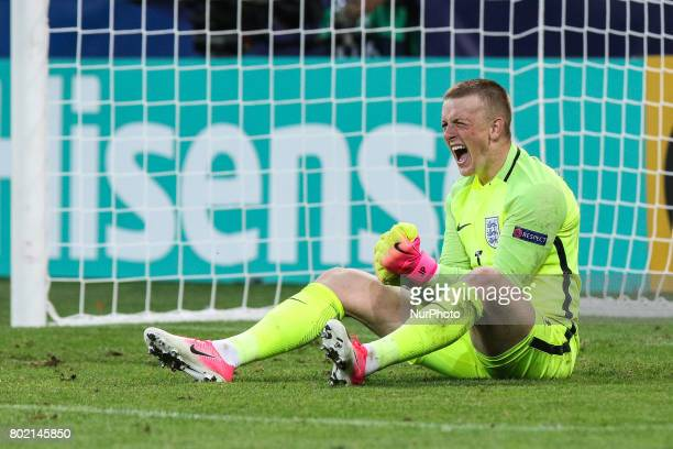 Jordan Pickford of Egland dives to make a save during the penalty shoot out during the UEFA European Under21 Championship Semi Final match between...