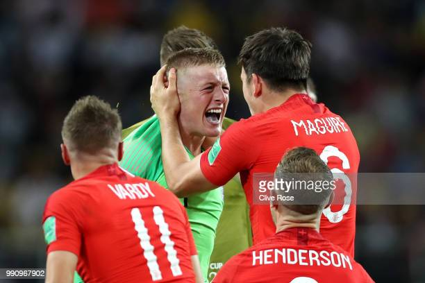 Jordan Pickford of England and Harry Maguire of England celebrate following their sides victory in the 2018 FIFA World Cup Russia Round of 16 match...