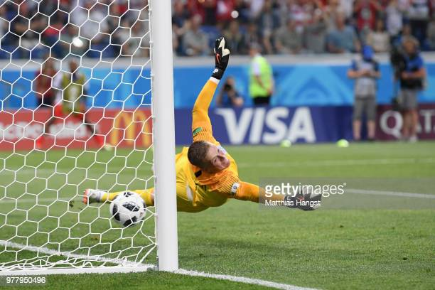 Jordan Pickford of England attempts to make a save as a goal is scored by Ferjani Sassi of Tunisia during the 2018 FIFA World Cup Russia group G...