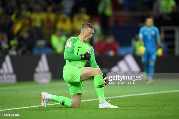 Jordan Pickford of England celebrates after he saves the fifth penalty from Carlos Bacca of Colombia in the penalty shoot out during the 2018 FIFA...