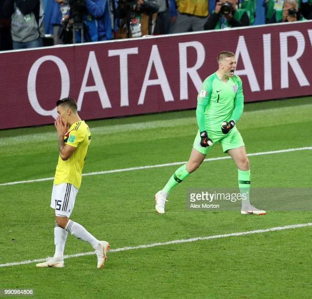 Jordan Pickford of England celebrates after Mateus Uribe of Colombia misses his side's fourth penalty in the penalty shoot out during the 2018 FIFA...
