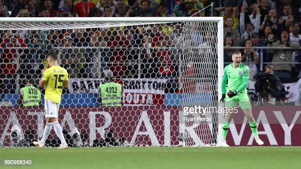 Jordan Pickford of England celebrates after Mateus Uribe of Colombia misses his team's fourth penalty in the penalty shoot out during the 2018 FIFA...