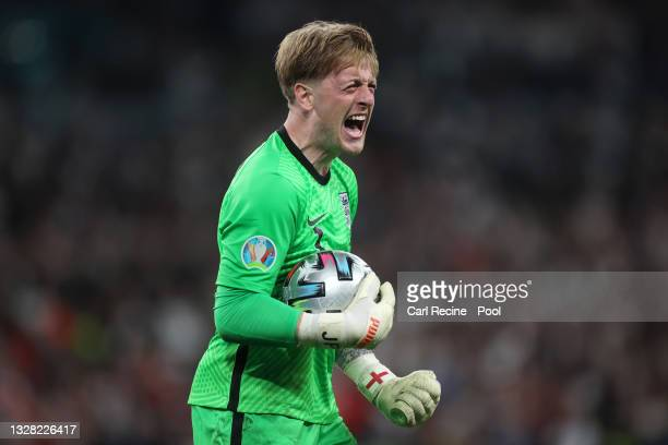 Jordan Pickford of England celebrates saving a penalty in the penalty shoot out during the UEFA Euro 2020 Championship Final between Italy and...