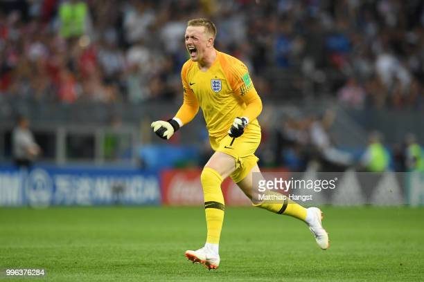 Jordan Pickford of England celebrates the opening goal scored by Kieran Trippier during the 2018 FIFA World Cup Russia Semi Final match between...