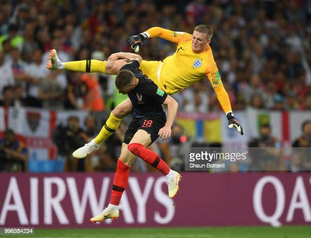 Jordan Pickford of England collides with Ante Rebic of Croatia during the 2018 FIFA World Cup Russia Semi Final match between England and Croatia at...