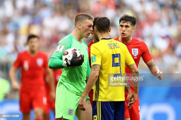 Jordan Pickford of England confronts Marcus Berg of Sweden during the 2018 FIFA World Cup Russia Quarter Final match between Sweden and England at...
