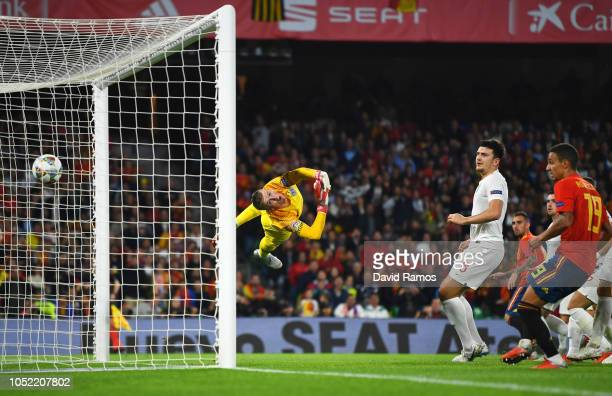 Jordan Pickford of England fails to stop Paco Alcacer of Spain from scoring his team's first goal during the UEFA Nations League A Group Four match...