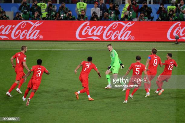 Jordan Pickford of England is celebrated by team mates during penalty shoot out during the 2018 FIFA World Cup Russia Round of 16 match between...