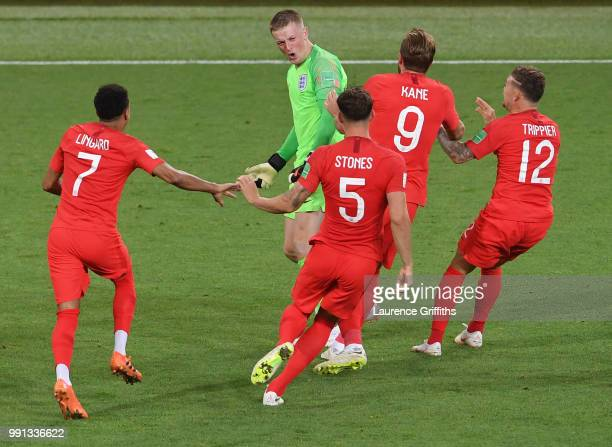 Jordan Pickford of England is congratulated by Jesse Lingard John Stones Harry Kane and Kieran Trippier after victory during the 2018 FIFA World Cup...