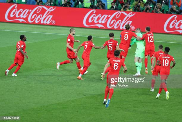 Jordan Pickford of England is mobbed by teammates in celebration after penalty shootout following the 2018 FIFA World Cup Russia Round of 16 match...