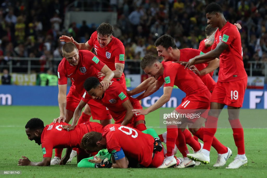 Jordan Pickford of England is mobbed by teammates in celebration after penalty shootout following the 2018 FIFA World Cup Russia Round of 16 match between Colombia and England at Spartak Stadium on July 3, 2018 in Moscow, Russia.