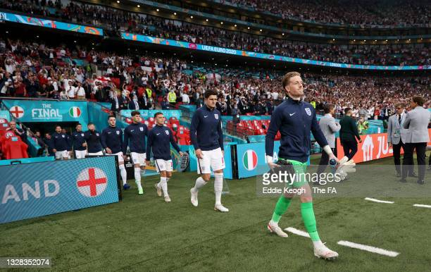 Jordan Pickford of England leads his side out prior to the UEFA Euro 2020 Championship Final between Italy and England at Wembley Stadium on July 11,...