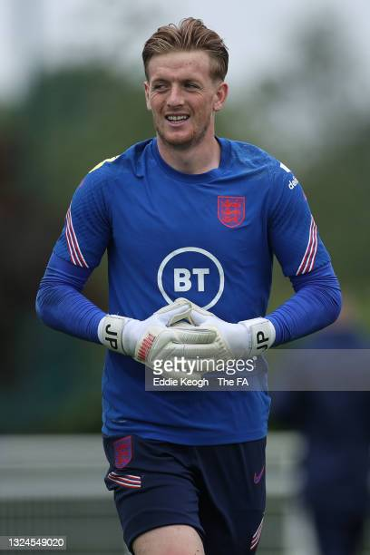 Jordan Pickford of England looks on during the England Training Session at Tottenham Hotspur Training Ground on June 20, 2021 in Burton upon Trent,...