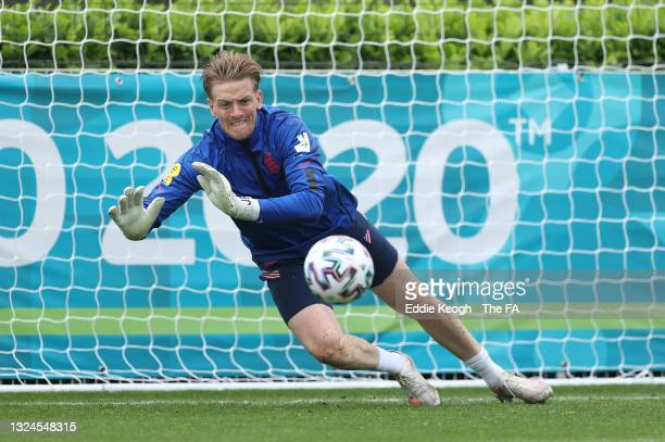 Jordan Pickford of England makes a save during the England Training Session at Tottenham Hotspur Training Ground on June 20, 2021 in Burton upon...