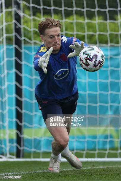 Jordan Pickford of England makes a save during the England Training Sat Tottenham Hotspur Training Ground on June 20, 2021 in Burton upon Trent,...