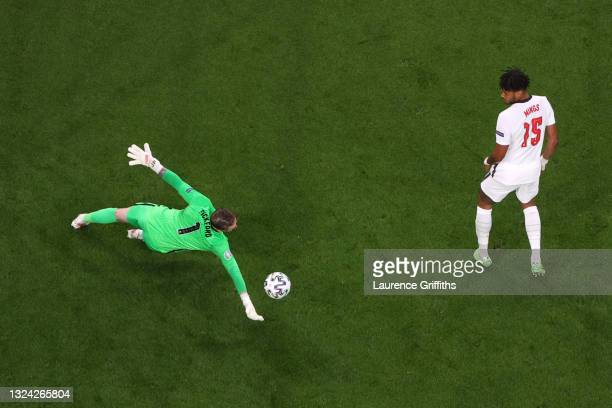 Jordan Pickford of England makes a save from a shot from Stephen O'Donnell of Scotland during the UEFA Euro 2020 Championship Group D match between...