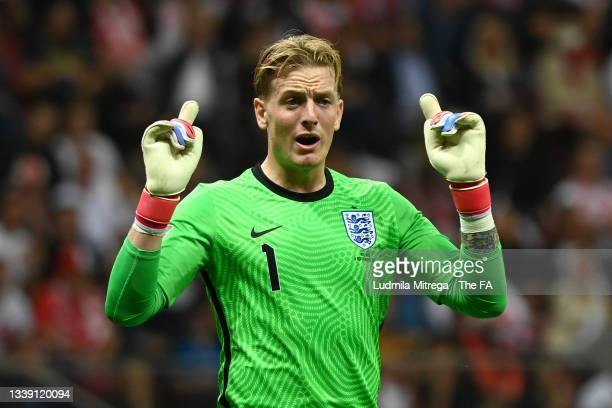 Jordan Pickford of England reacts during the 2022 FIFA World Cup Qualifier match between Poland and England at Stadion Narodowy on September 08, 2021...