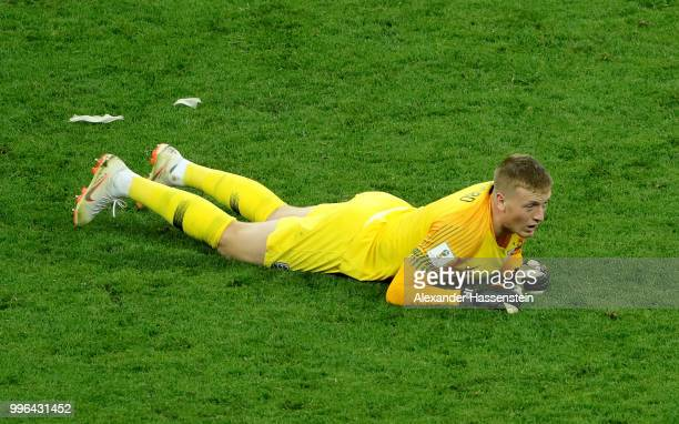 Jordan Pickford of England reacts following the 2018 FIFA World Cup Russia Semi Final match between England and Croatia at Luzhniki Stadium on July...