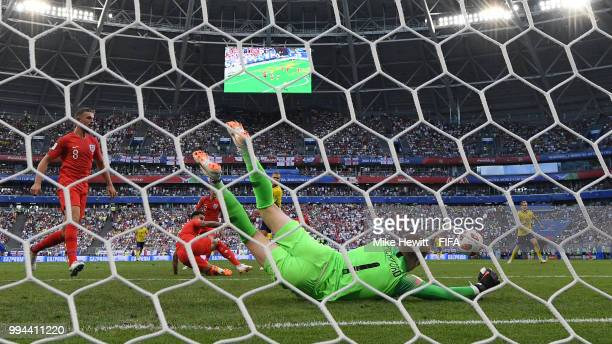 Jordan Pickford of England saves a shot from Viktor Claesson of Sweden during the 2018 FIFA World Cup Russia Quarter Final match between Sweden and...