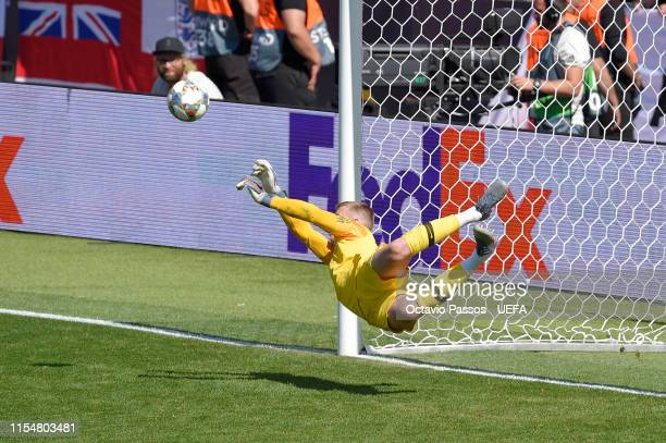 Jordan Pickford of England saves the decisive penalty during the penalty shootout in the UEFA Nations League Third Place Playoff match between...