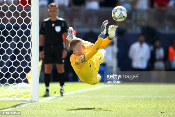 Jordan Pickford of England saves the decisive penalty of Josip Drmic of Switzerland during the penalty shootout in the UEFA Nations League Third...