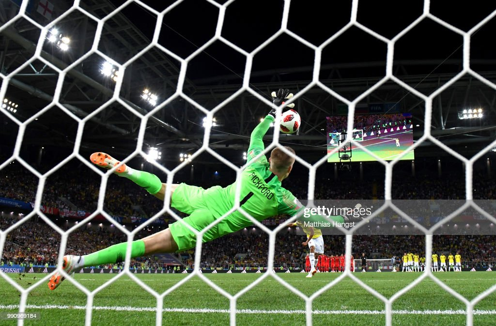 Jordan Pickford of England saves the fifth penalty from Carlos Bacca of Colombia in the penalty shoot out during the 2018 FIFA World Cup Russia Round of 16 match between Colombia and England at Spartak Stadium on July 3, 2018 in Moscow, Russia.