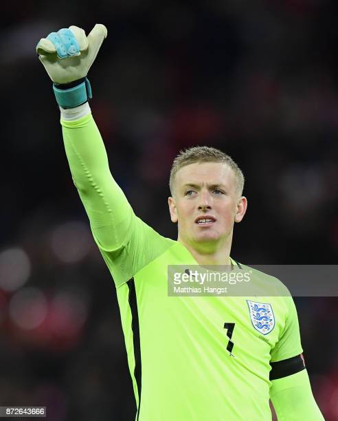 Jordan Pickford of England shows appreciation to the fans after the International friendly match between England and Germany at Wembley Stadium on...