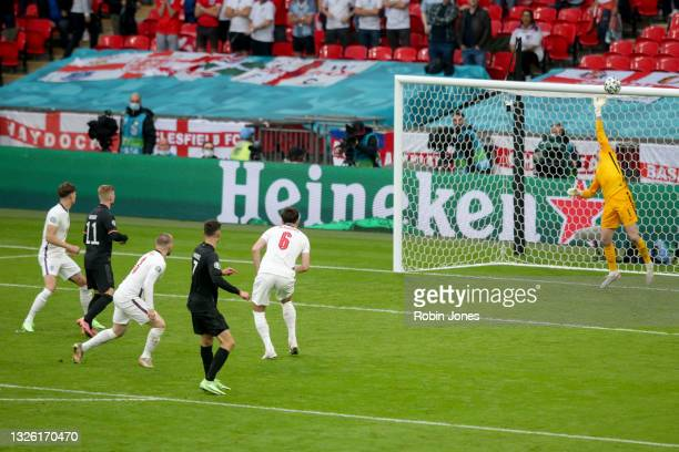 Jordan Pickford of England tips over the shot by Kai Havertz of Germany during the UEFA Euro 2020 Championship Round of 16 match between England and...