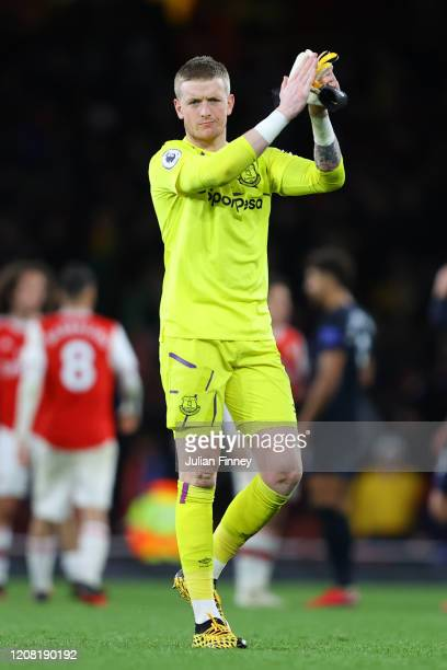 Jordan Pickford of Everton acknowledges the fans during the Premier League match between Arsenal FC and Everton FC at Emirates Stadium on February 23...