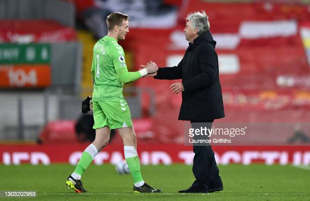 Jordan Pickford of Everton and Carlo Ancelotti, Manager of Everton celebrate following their team's victory in the Premier League match between...