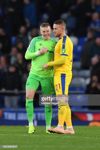 Jordan Pickford of Everton and Connor Wickham of Crystal Palace hug after the Premier League match between Everton FC and Crystal Palace at Goodison...