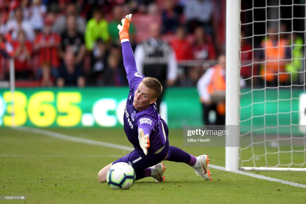 Jordan Pickford of Everton attempts to make a save as Joshua King of AFC Bournemouth (not pictured) scores his team's first goal from a penalty during the Premier League match between AFC Bournemouth and Everton FC at Vitality Stadium on August 25, 2018 in Bournemouth, United Kingdom.