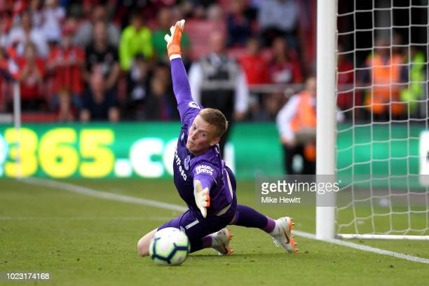 Jordan Pickford of Everton attempts to make a save as Joshua King of AFC Bournemouth scores his team's first goal from a penalty during the Premier...