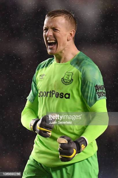 Jordan Pickford of Everton celebrates after teammate Richarlison scores their team's first goal during the FA Cup Fourth Round match between Millwall...