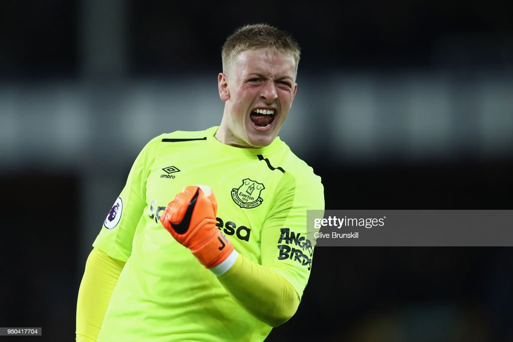 Jordan Pickford of Everton celebrates after Theo Walcott of Everton (not pictured) scores their sides first goal during the Premier League match between Everton and Newcastle United at Goodison Park on April 23, 2018 in Liverpool, England.