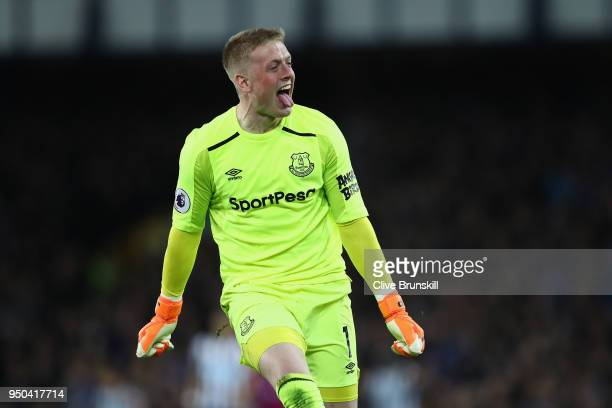 Jordan Pickford of Everton celebrates after Theo Walcott of Everton scores their sides first goal during the Premier League match between Everton and...