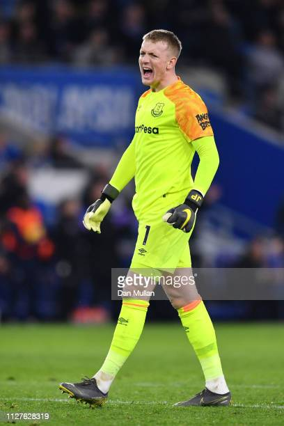 Jordan Pickford of Everton celebrates as Gylfi Sigurdsson scores his team's first goal during the Premier League match between Cardiff City and...