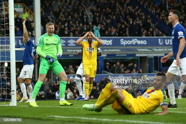 Jordan Pickford of Everton celebrates as he saves a penalty kick from Luka Milivojevic during the Premier League match between Everton FC and Crystal...