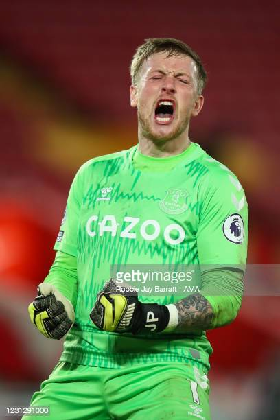 Jordan Pickford of Everton celebrates at full time during the Premier League match between Liverpool and Everton at Anfield on February 20, 2021 in...