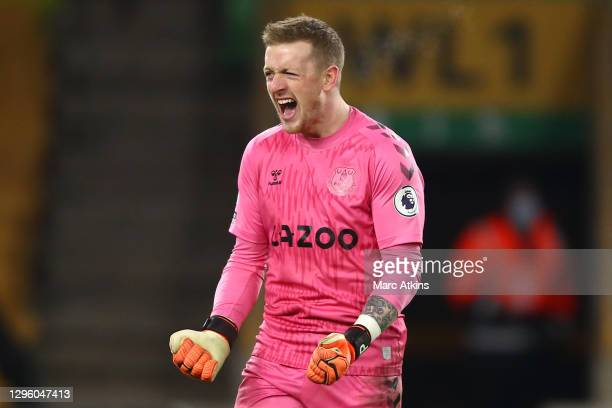 Jordan Pickford of Everton celebrates following his team's victory in the Premier League match between Wolverhampton Wanderers and Everton at...