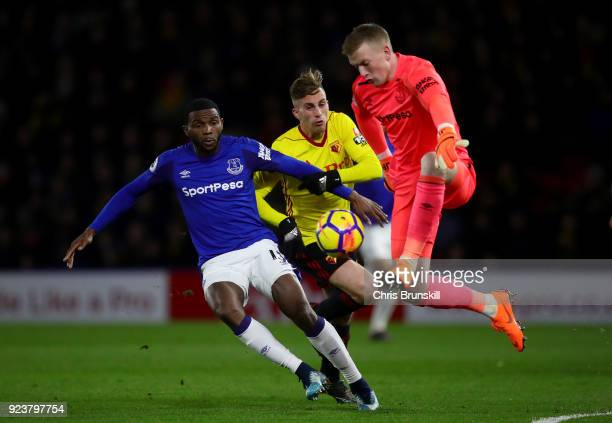 Jordan Pickford of Everton clears the ball away from Gerard Deulofeu of Watford as Oumar Niasse of Everton protects the space during the Premier...
