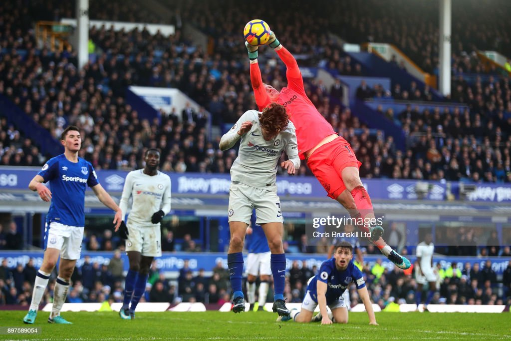 Jordan Pickford of Everton collects the ball under pressure from Marcos Alonso of Chelsea during the Premier League match between Everton and Chelsea at Goodison Park on December 23, 2017 in Liverpool, England.