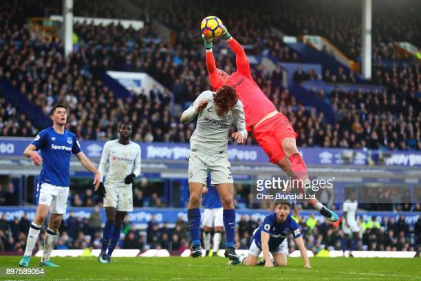 Jordan Pickford of Everton collects the ball under pressure from Marcos Alonso of Chelsea during the Premier League match between Everton and Chelsea...