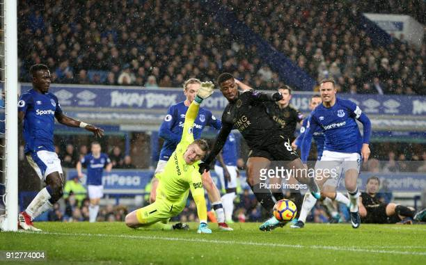 Jordan Pickford of Everton denies Kelechi Iheanacho of Leicester City from scoring during the Premier League match between Everton and Leicester City...