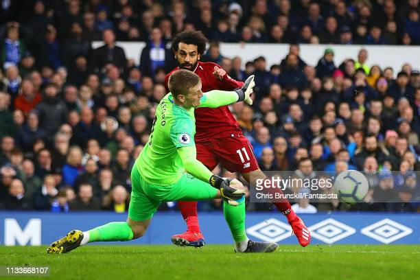 Jordan Pickford of Everton denies Mohamed Salah of Liverpool during the Premier League match between Everton FC and Liverpool FC at Goodison Park on...