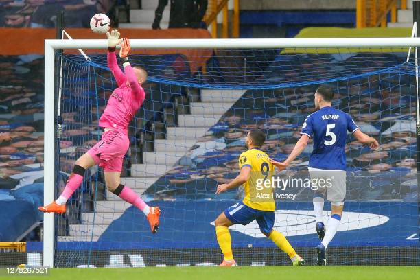 Jordan Pickford of Everton drops the ball leading to Neal Maupay of Brighton and Hove Albion scoring his team's first goal during the Premier League...